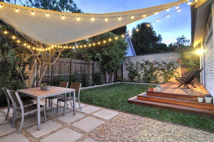 West Hollywood back yard Redwood platform deck, gravel / square paver patio, sail shade, string lights & landscape design.