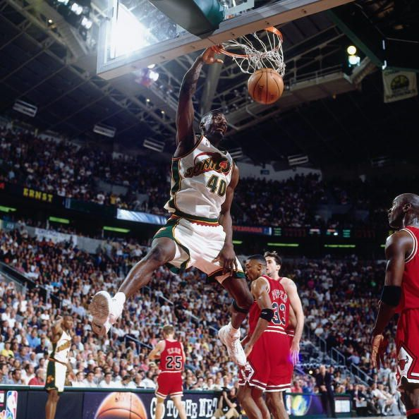 Shawn Kemp of the Seattle SuperSonics dunks in Game Three of the 1996 NBA Finals against the Chicago Bulls at Key Arena on June 9 1996 in Seattle...