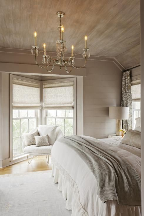 White and beautiful, lovely exposed wood on ceiling.