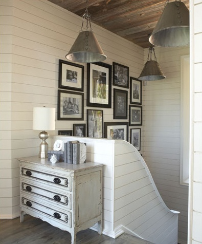 love this look- horizontal painted wood plank walls, industrial lights, gallery wall and reclaimed wood ceiling