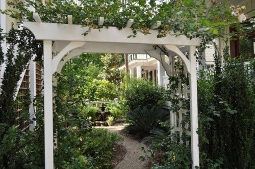 I like the white arbor. Had been thinking wrought iron, but this white really stands out. Might get gross after a few years though...