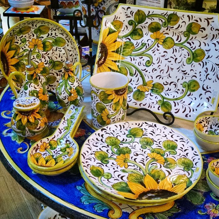 """These sunny yellow Tuscan sunflowers bloomed just-in-time to grace your Mediterranean-inspired home. It's easy to see why Girasole Giallo (""""Yellow Sunflower"""") is named as such, with its sunny yellow sunflowers, bright green leaves and espresso-colored accents. Handmade and hand-painted in Tuscany, food and dishwasher safe, Giallo Girasole is as bright and cheerful as Springtime all year round."""