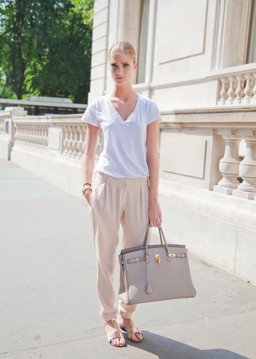 White v-neck t-shirt, beige harem pants, beige sandals. gray bag