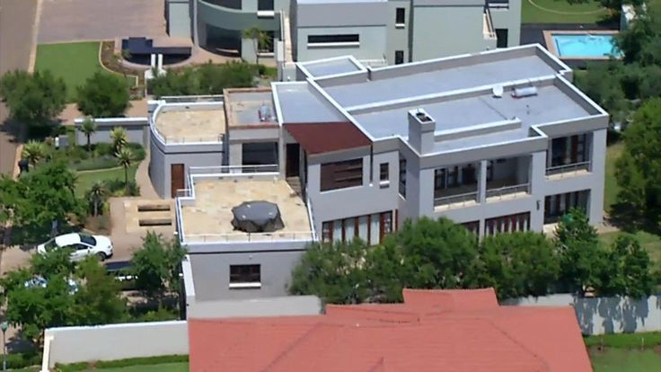 This image displays the house of Oscar Pistorious, where the crime scene occurred at, resulting on Revaa's death. The house is situated in Silver Woods Country Estate home in Pretoria