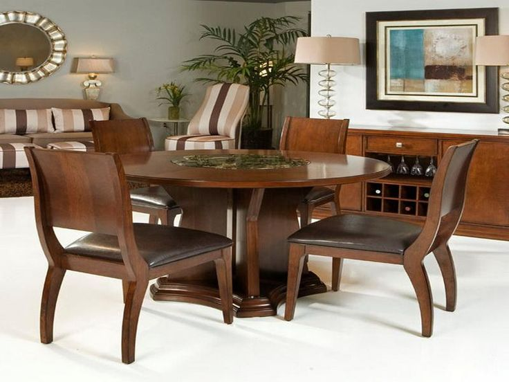 wooden round dining table design with mirror and table lamp