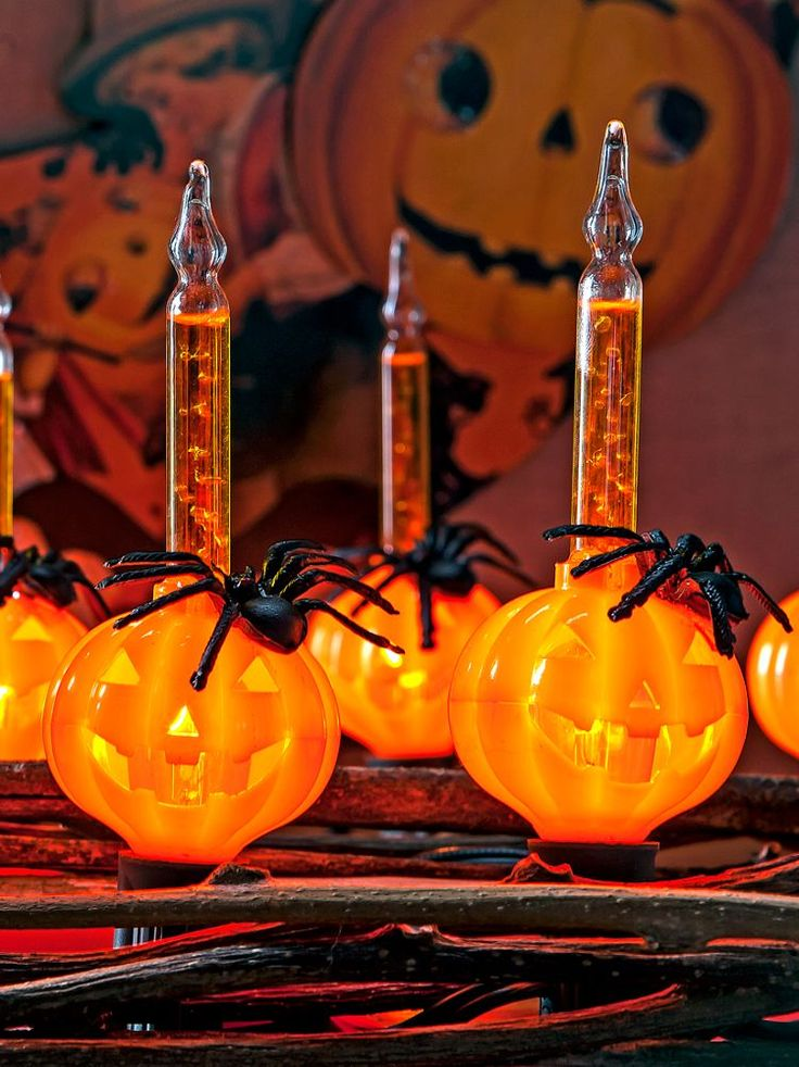 halloween bubble lights strings of jack o lanterns decorated with black spiders and filled with orange liquid that begins to bubble when the novelty