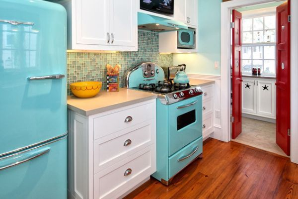 Small, eclectic kitchen with wooden floors and robin egg blue appliances