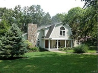 Cute Connecticut home tucked among a woodland forest. #dreamhome #chimney