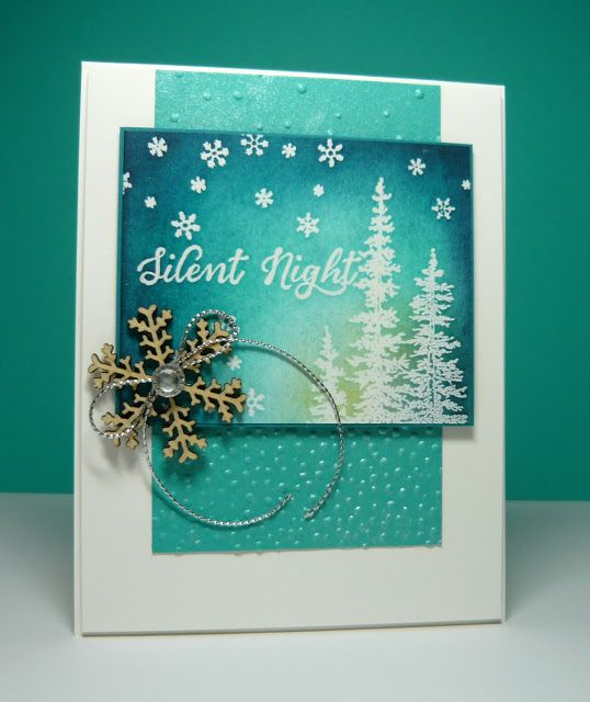 Love this handmade Christmas card in nontraditional blue colors. Clear embossed trees on the sponged background match the falling snowflakes, both from the Wonderland stamp set.