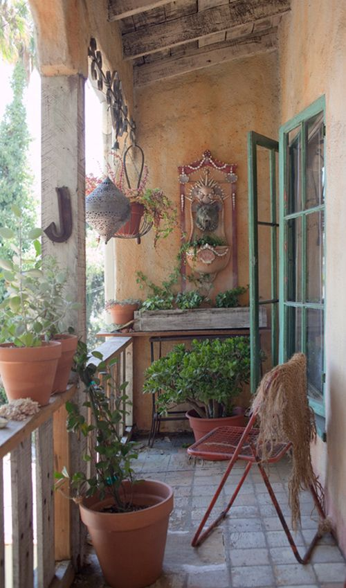 Balcony garden: a bit narrower than our balcony but it uses the space well. Does not overwhelm with plants. Some people use/some plant use.