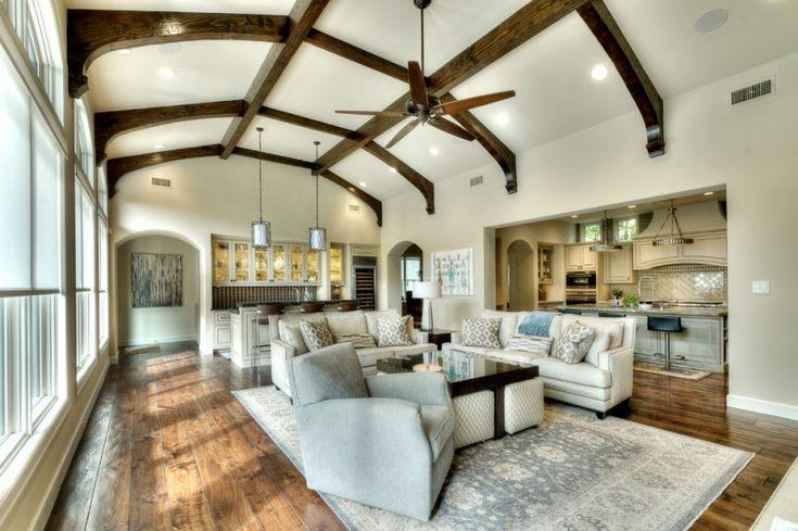 dark harwood floor grey sofa decorative archway area rug wine storage kitchen bar wood ceiling beams of Inspiring Mediterranean Interior Designs