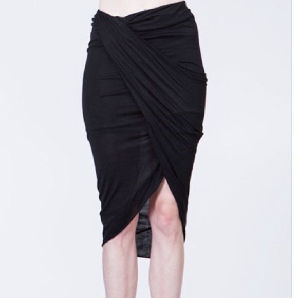 Sale • Ark & Co. draped asymmetrical jersey skirt ⚠️DO NOT BUY THIS LISTING ⚠️ Comment with your size and I'll make a listing for you.                 Draped asymmetrical jersey skirt, lined, 100% viscose. High quality and versatile. Runs true to size. No trades, no offers. Ark & Co Skirts