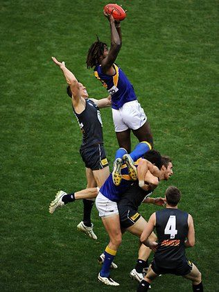 aussie rules footy. NOT soccer! better than gridiron cos these boys dont wear all the padding