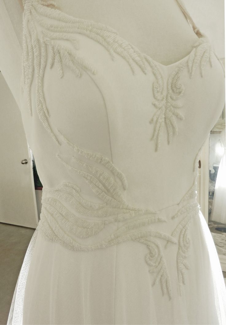 This beautiful wedding dress is what I am currently working on. The fitted silk crepe gown is layered with soft tulle in the skirt. Custom-beaded in the bodice the style features a low back with cross over, beaded straps.. #wedding #dress #beaded #pretty