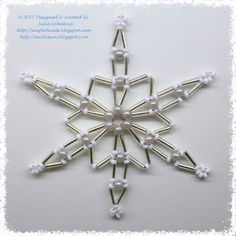 Snowflake of bugle beads, seed beads and round beads