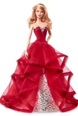 "2015 Holiday Barbie™ Doll | The Barbie Collection Lacy white ""branches"" frame our radiant Barbie® doll dressed in a ruffly red holiday gown embellished with a silvery brocade inset. An intricately sculpted, silvery trim accents her sweetheart neckline."