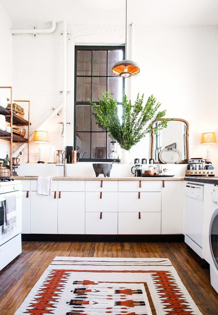 Turkish and Persian rugs - The mix of passionate color and soulful pattern work is enough to bring a dose of high-spirited exoticism to even the most minimal of looks. We're especially loving the look with an all-white kitchen.