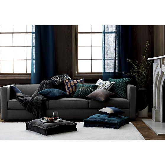 Impromptu seating on the main floor. Oversized tufted blue/green square sits plush in velvet, finished modern with mitered raw edges in multilayers. 100% velvety cotton cover with 100% poly fill.