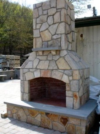 "Finished 48"" Contractor Series Outdoor Fireplace Kit with decorative mantel accent-- veneered with South Bay Quartzite."