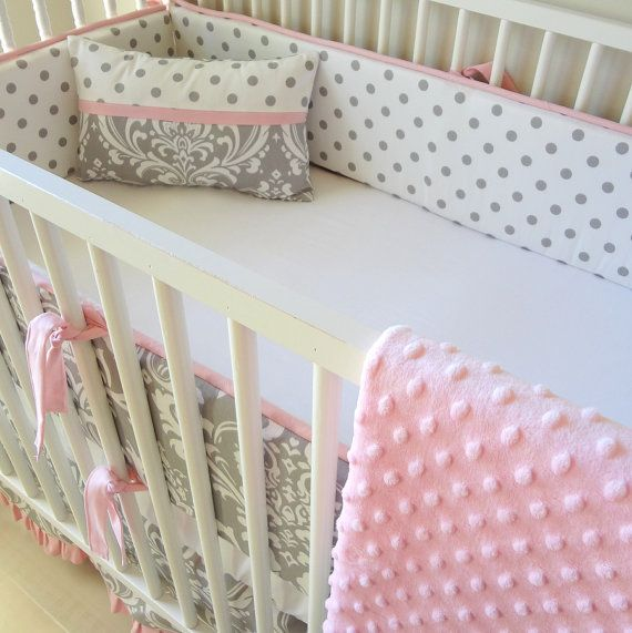This beautiful bedding features a gray and white damask and white and gray polka dot accented in pink. The bumpers are made with removable foam