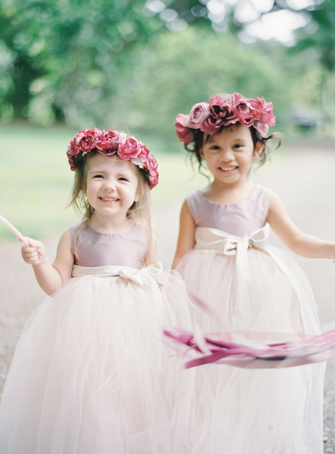 Adorable flower girls in a little pop of color: http://www.stylemepretty.com/2016/11/17/berry-wedding-color-ideas/ Photography: The Great Romance - http://thegreatromancephoto.com/