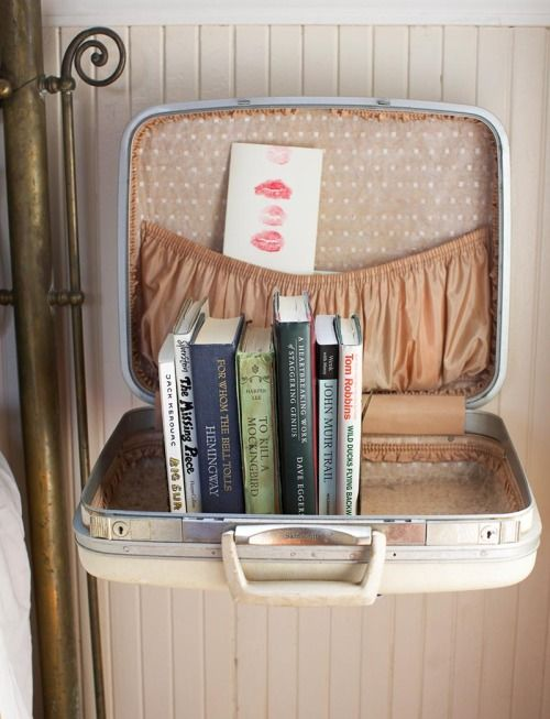The bedroom shelf from Julie Martin's home tour on Design*Sponge (made from an old suitcase!) #diy #bedroom