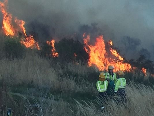 The fight to control two huge blazes in Christchurch's Port Hills could last the week.
