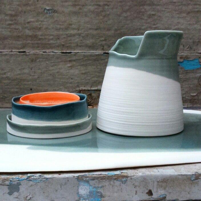Porcelain vessels w asymmetric rim, porcelain tray. Handmade in England. Tableware,  interior design, orange, grey.  Ceramics.
