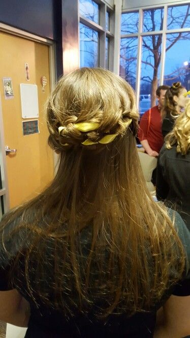 Waterfall braid with a ribbon, then tucked back underneath with bobby pins