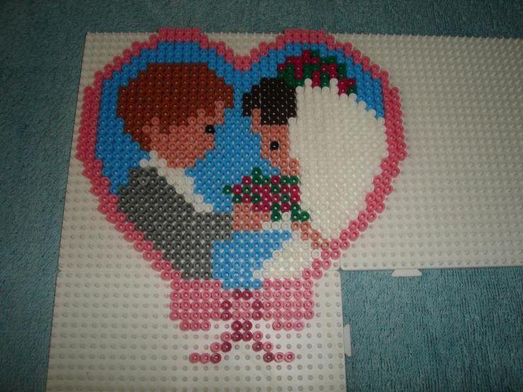 Les mariés en perles a repasser -Création réalisée par : isabelle8119