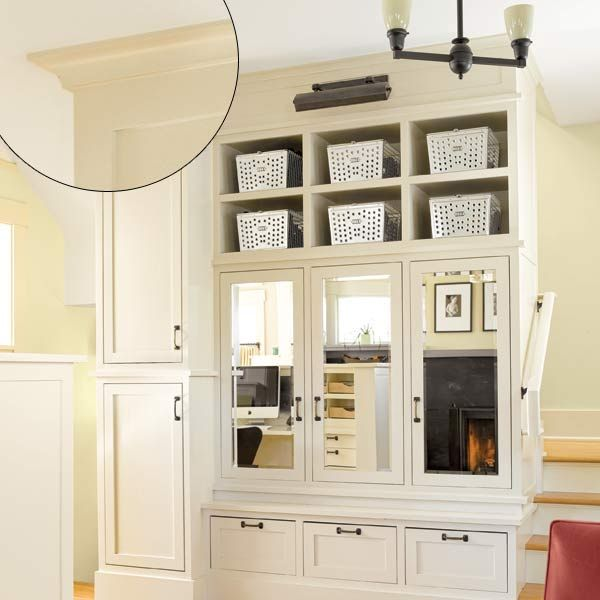 this is a nice way to hide the stairway and get storage  Photo: Alex Hayden | thisoldhouse.com | from 39 Crown Molding Design Ideas