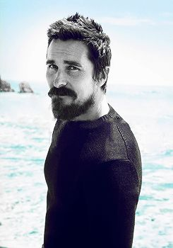Christian Bale with beard and muscles and chopped hair yup