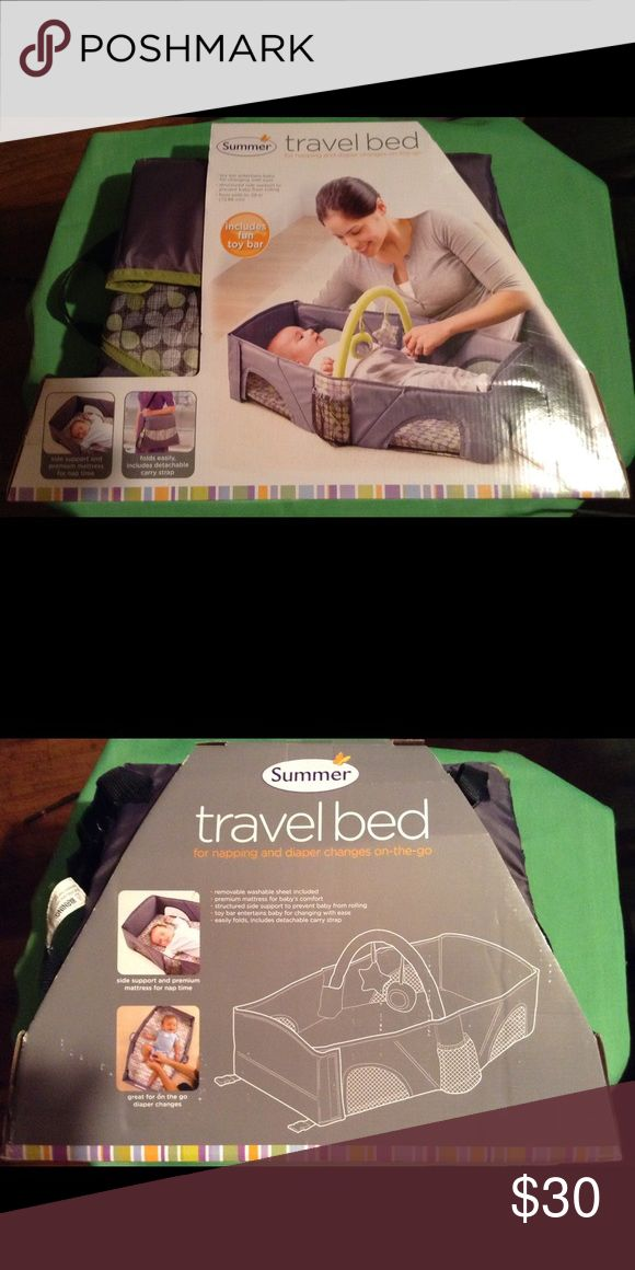 INFANT TRAVEL BED Infant travel bed for napping and diaper changes on the go! Toy bar entertains baby while being changed.  Side support to prevent baby from rolling. Mattress for nap time. Folds easily and includes a detachable carry strap. From birth to 29inc (73.66cm) SUMMER Other