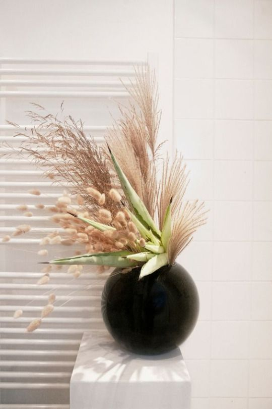 Dreamy dried arrangement in a minimal black vase