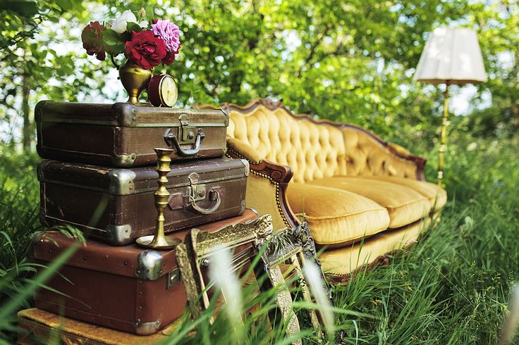 yellow vintage sofa with suitcases