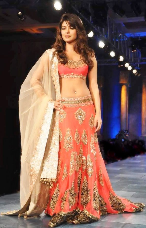 Manish malhotra orange lehenga -- I love the pattern on the skirt. It's a very traditional Indian buti that I have on a few of my outfits. But I'm always drawn to it!