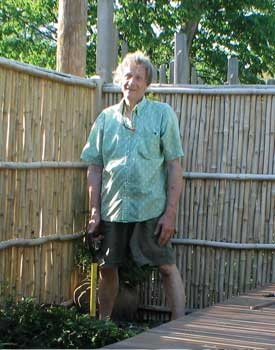 Robert Dainei Lund working in back yard of residence of June Tanoue and Robert Althouse.