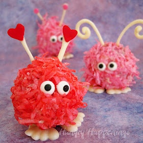 Cute cake pops.  Looks like those little fuzz balls with feet and googly eyes we used to get when I was little