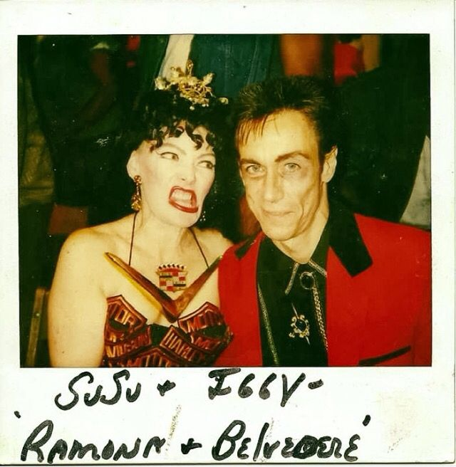 Susan Tyrrell and Iggy Pop at the wrap party for John Waters' Cry Baby. Love Susu's Cadillac necklace!