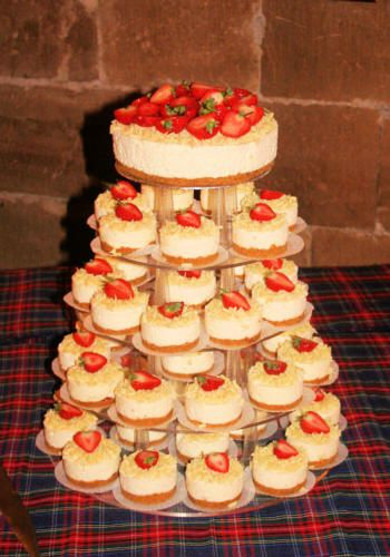 Cheesecake wedding cake, whole cake at the top for the topper and then individual ones on the stand