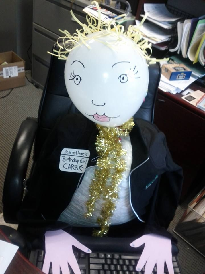 Office Birthday Humor - Surprise your co-workers on their birthday their very own Birthday double made with little effort & random stuff found in the office!  LOL - Materials - Head - White Balloon, Hair -shredded scrap paper taped to balloon Body - garbage bag of shredded office paper - Hands - more office paper - neclace - left over garland from christmas.  - Get creative & make your own!
