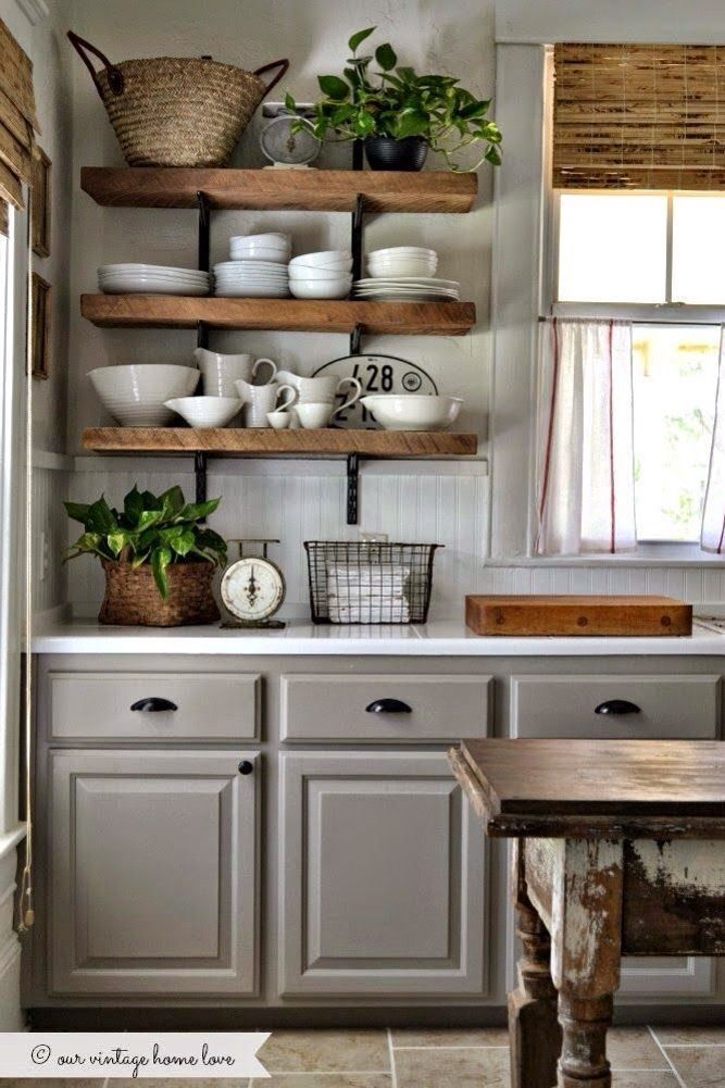 love the cabinet & wall color, white countertop and  black hardware.