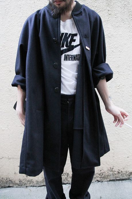 coat and Nike shirt