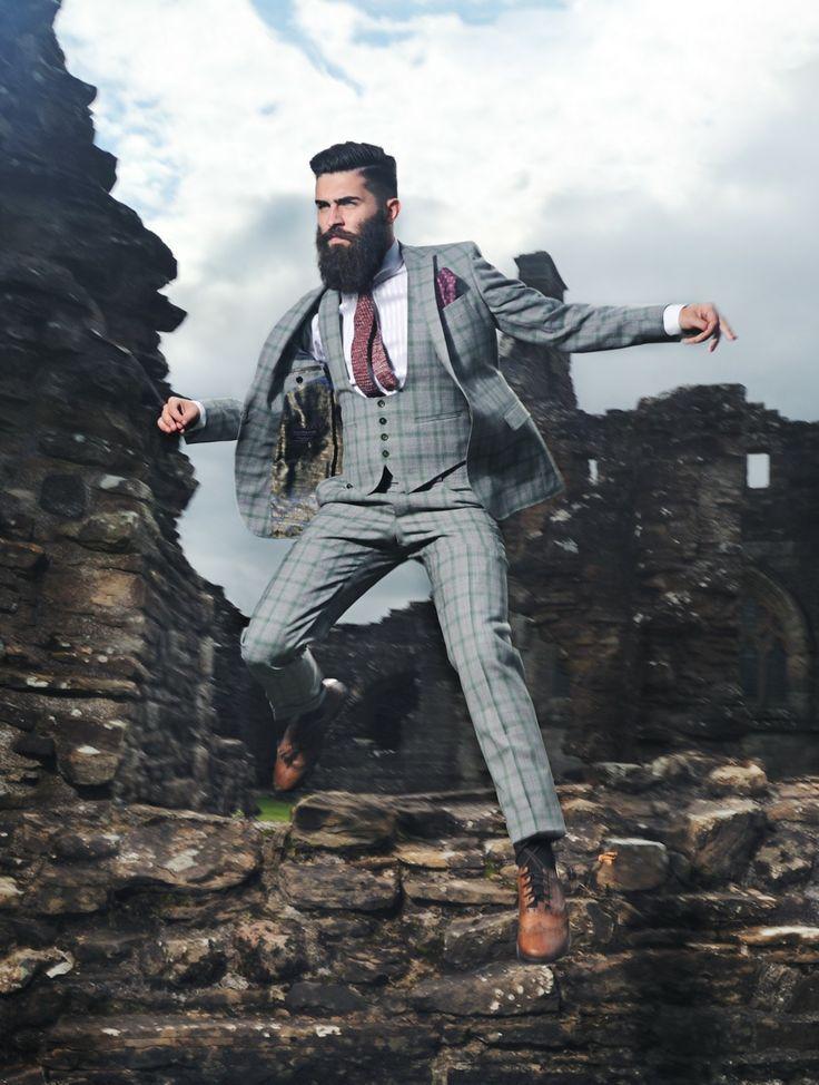 Shop this look on Lookastic:  http://lookastic.com/men/looks/brogues-dress-pants-waistcoat-blazer-pocket-square-tie-dress-shirt-socks/731  — Tan Leather Brogues  — Grey Plaid Dress Pants  — Grey Plaid Waistcoat  — Grey Plaid Blazer  — Burgundy Polka Dot Pocket Square  — Burgundy Polka Dot Tie  — White and Blue Vertical Striped Dress Shirt  — Black Socks