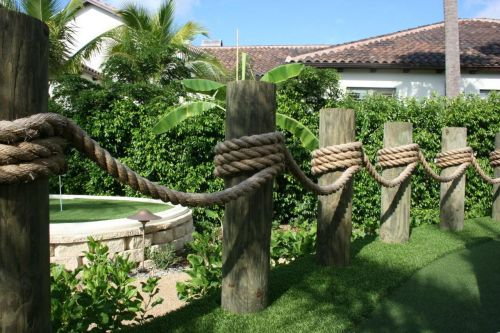 Another nautical rope railing idea outdoors garden for Garden decking with rope