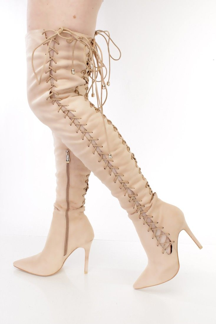 Stay warm and stylish this season with these sexy thigh high heel boots! The features include a faux suede upper with a woven lace up tie cut out design, pointed closed toe, stitched trim, inner side zipper closure, smooth lining, and cushioned footbed. Approximately 4 1/2 inch heels, 16 inch circumference, and 23 1/2 inch shaft.