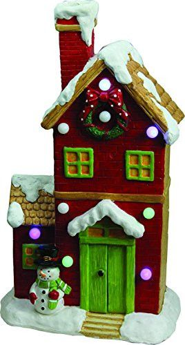 Felices Pascuas Collection 21 inch Christmas Morning Pre-Lit LED Snow Covered House with Snowman Musical Christmas Tabletop Decoration