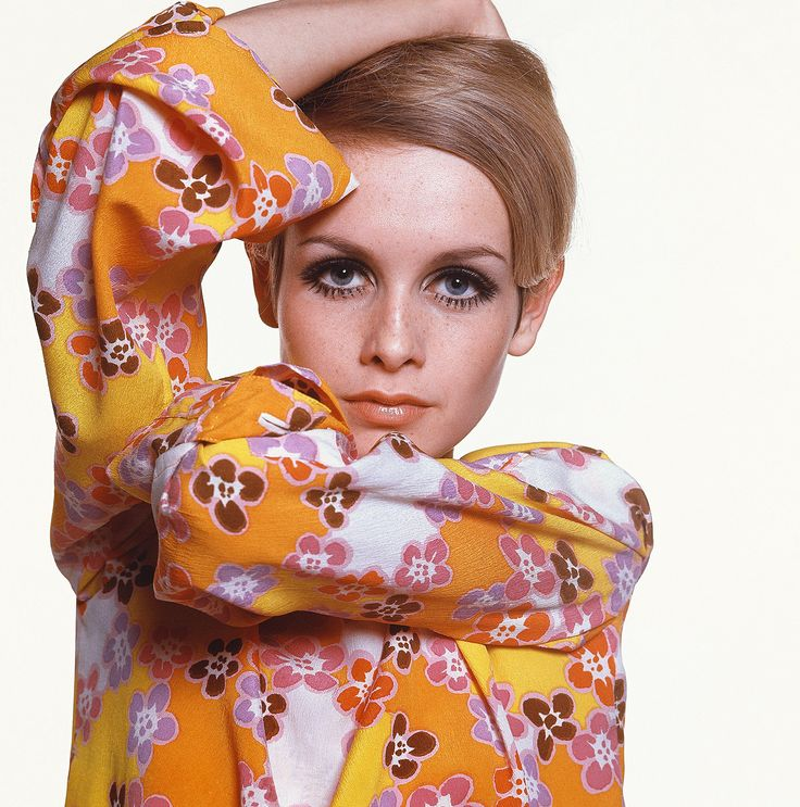 """The iconic picture """"Twiggy"""", photographed by Bert Stern, shows the superstar model wearing a bright, colorful flower-print dress, with a makeup outlining her large doe eyes. The image appeared in Vogue in 1967."""