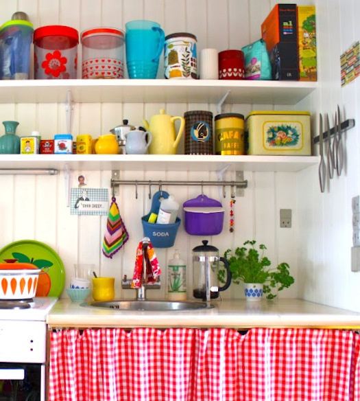 colourful containers on display  and cheerful red check curtains for a welcoming kitchen