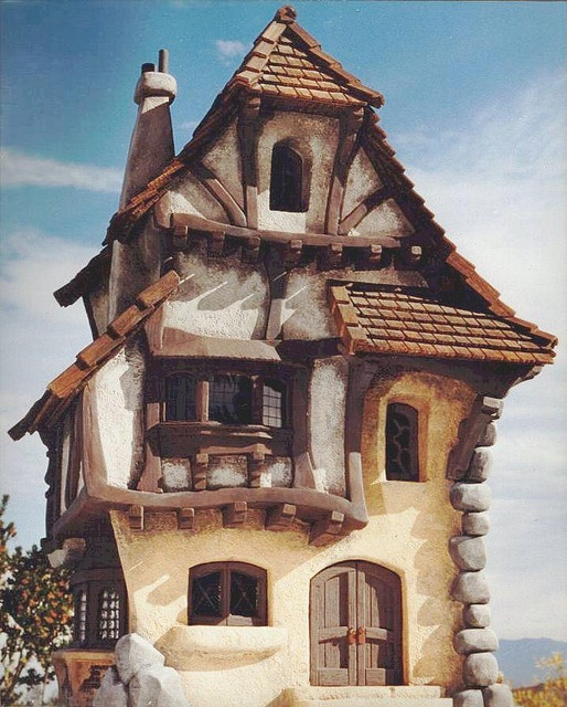 I love the design of this home.  At some point I want to build my custom home in Tahoe - a cute storybook themed home - and add some more brick/rock to this and I think it would be so cute.